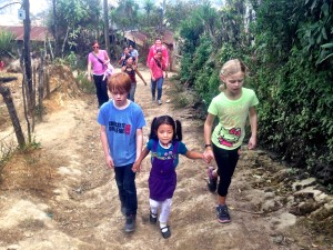 Leading Delmi home from school